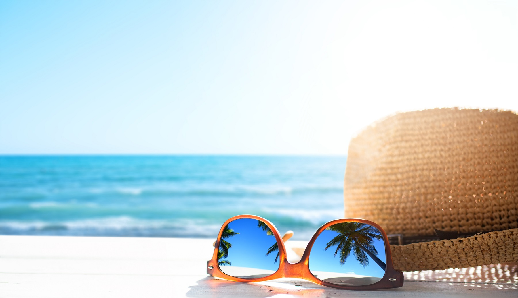 hat and sunglasses on a Vacation Rentals Vs. Hotels