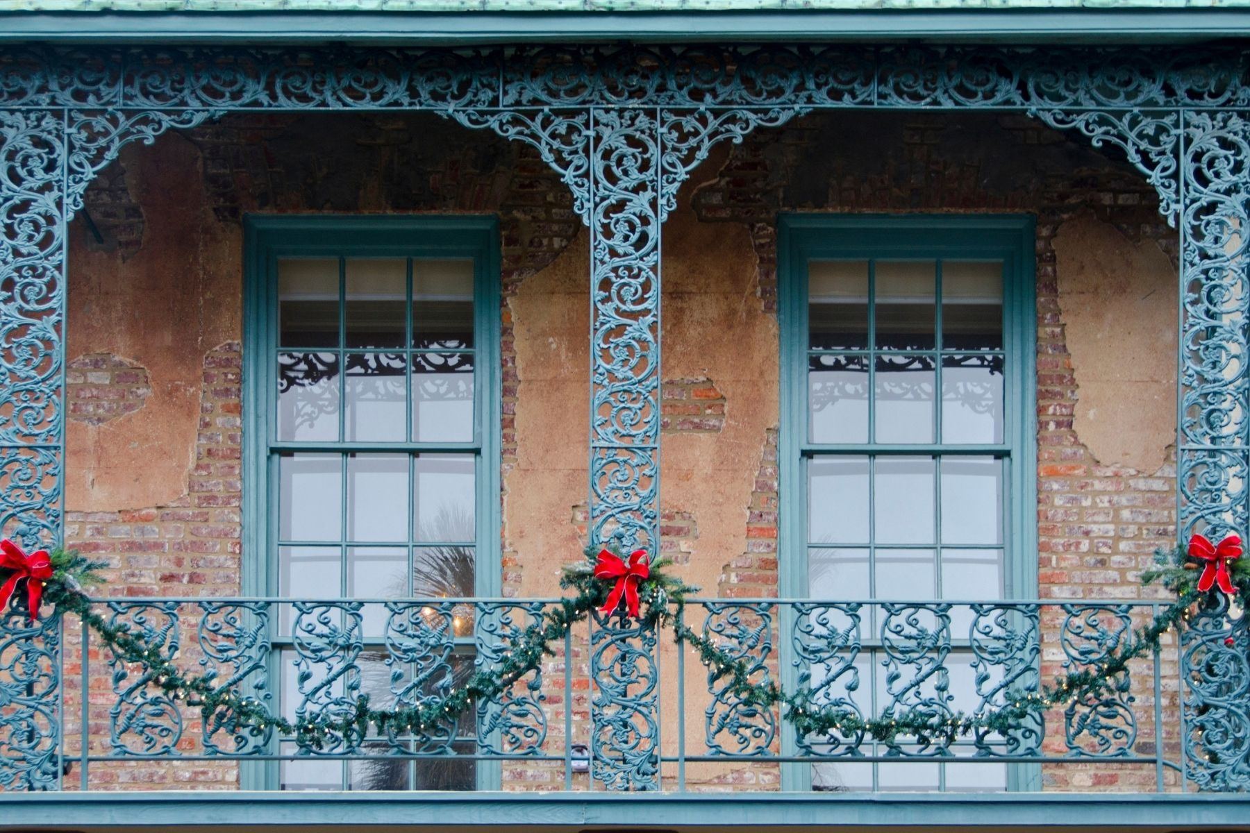 A property with holiday wreaths in Charleston in December